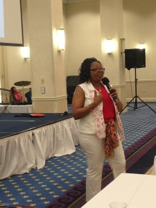 Dr. Pauline informing the audience about going into Intercessor and how it feels.
